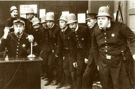 Parking signs and keystone cops