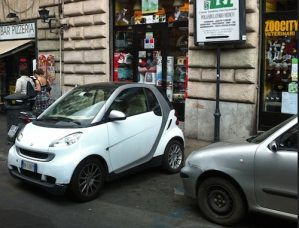 This image shows a car parallel parking while another car was parked on an angle