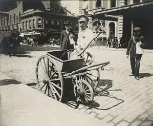 This image is a vintage NYC street sweeper