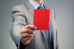 This image of a red card relates to the question of disqualification from City Hall service