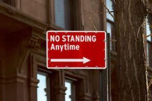 no sranding anytime sign. Keep moving.
