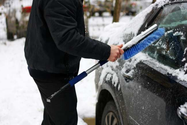 Road trip tips to stay safe with snow car scraper New York Rentals