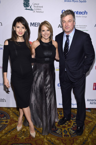"""NEW YORK, NEW YORK - APRIL 09: (L-R) Hilaria Baldwin, Katie Couric and Alec Baldwin attend Stand Up To Cancer's New York Standing Room Only, presented by Entertainment Industry Foundation, with donors American Airlines and Merck, chaired by Jim Toth, Reese Witherspoon & MasterCard President/CEO Ajay Banga and his wife Ritu, honoring Katie Couric at Cipriani Wall Street on April 9, 2016 in New York City. (Photo by Dimitrios Kambouris/Getty Images for EIF)"""