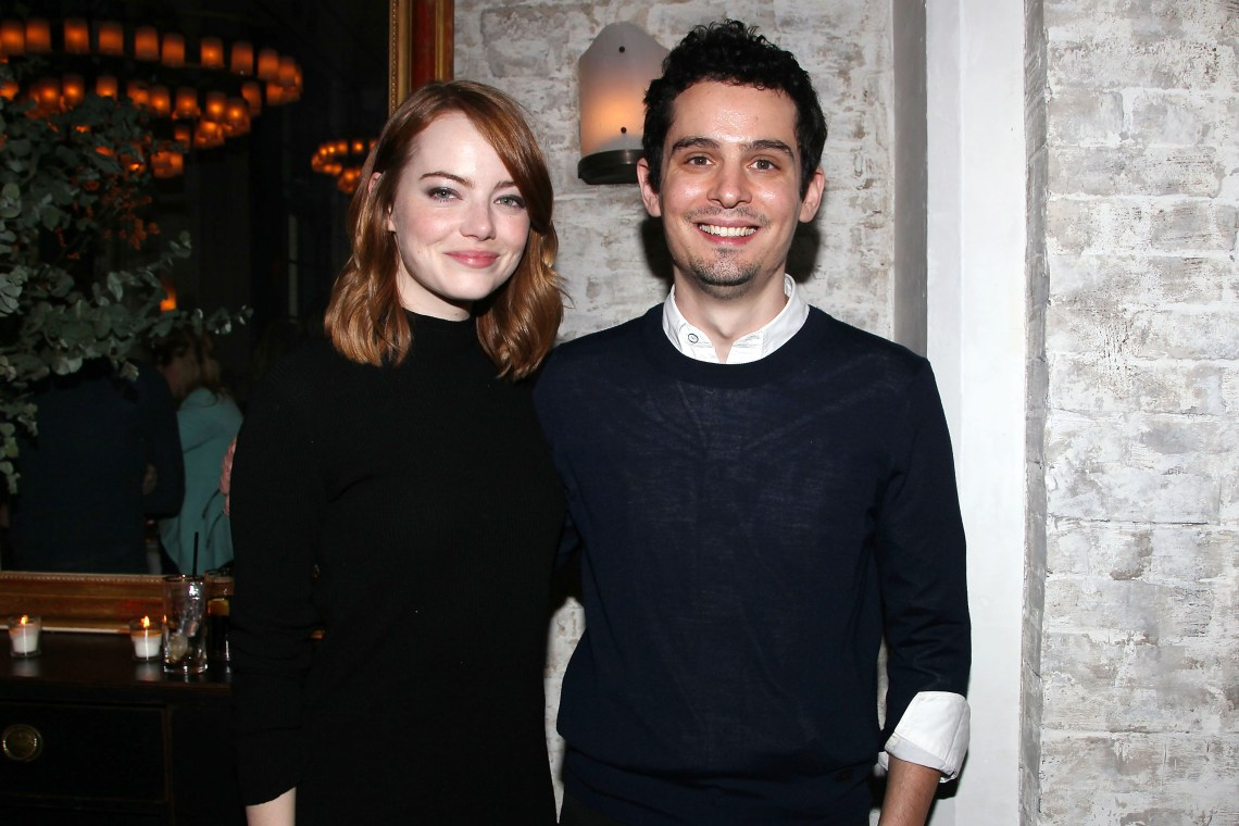 """New York, NY - - 11/27/16 -Bulleit Bourbon Hosts a Luncheon to Celebrate """"LA LA LAND"""" at Le Coucou. The film is written and directed by Damien Chazelle, and stars Emma Stone and Ryan Gosling. It releases in theaters on December 16th, 2016. -Pictured: Emma Stone and Damien Chazelle (Director) -Photo by: Kristina Bumphrey/StarPix"""