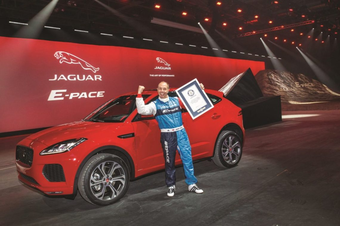 Jaguar stunt driver Terry Grant celebrates after setting a new Guinness World Record for longest barrel roll at the global launch of the new Jaguar E-PACE at ExCel London.