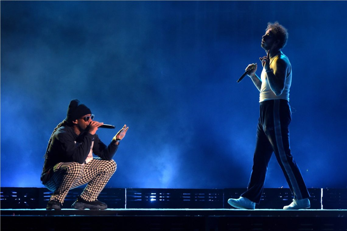 Ty Dolla $ign (L) and Post Malone perform onstage during the 2018 American Music Awards