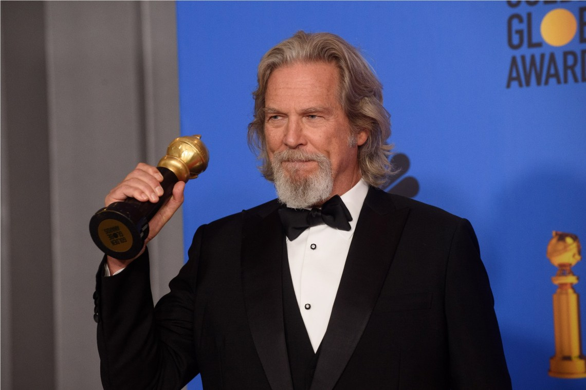 "Jeff Bridges poses backstage with the Cecil B. DeMille Award for his ""outstanding contribution to the entertainment field"" at the 76th Annual Golden Globe Awards at the Beverly Hilton in Beverly Hills, CA on January 6, 2019."