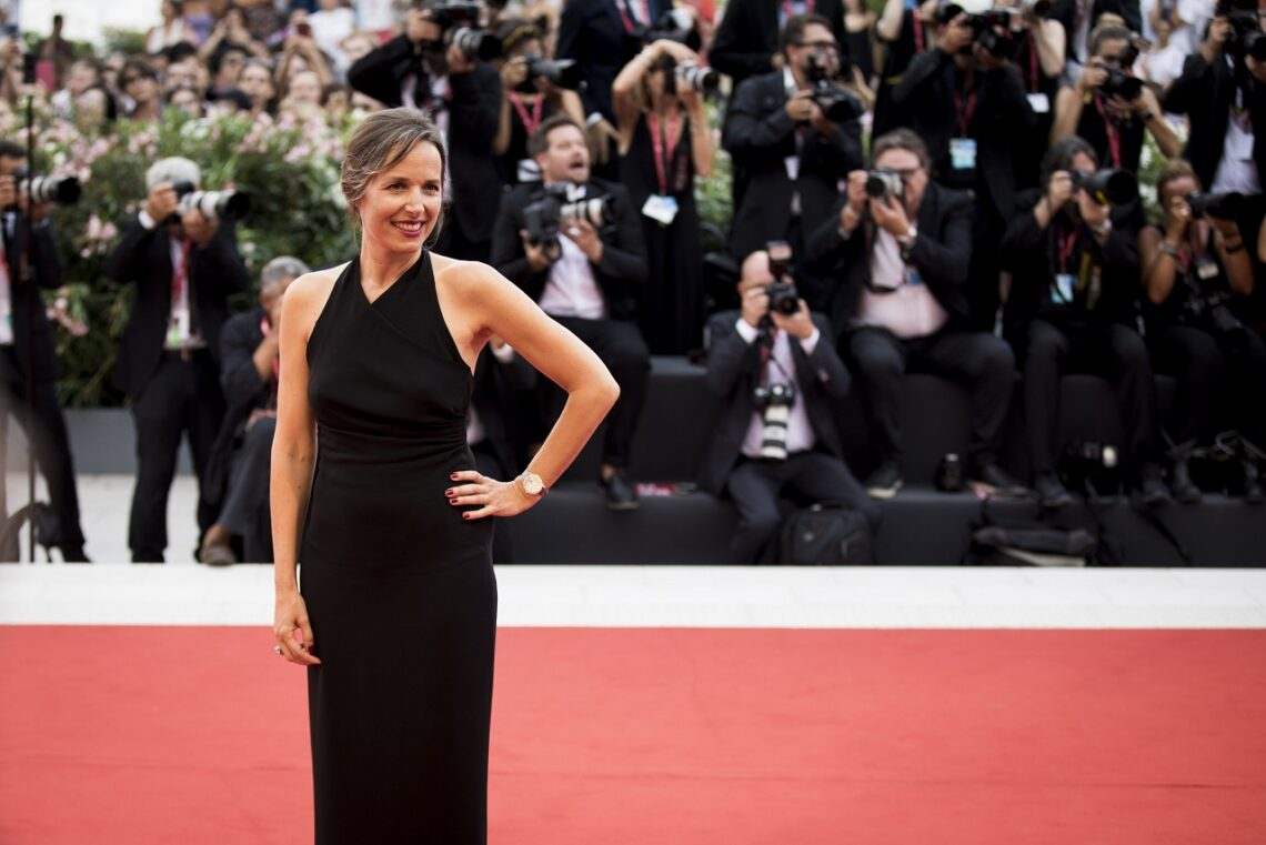 "VENICE, ITALY - AUGUST 28: CEO Jaeger-LeCoultre Catherine Renier wearing a Jaeger-LeCoultre watch walks the red carpet ahead of the Opening Ceremony and the ""La Vérité"" (The Truth) screening during the 76th Venice Film Festival at Palazzo del Cinema on August 28, 2019 in Venice, Italy. (Photo by Tristan Fewings/Getty Images for Jaeger-LeCoultre)"