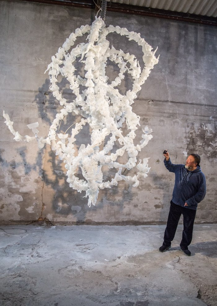 Ai Weiwei at the Berengo studio in Venice, next to his glass sculpture Blossom Chandelier. Photo by Karolina Sobel.