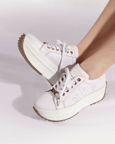 White walking shoes with curved sole by Cult