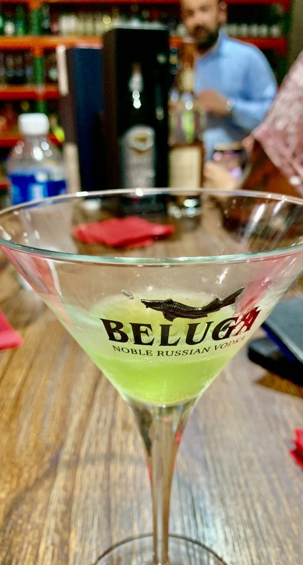 Pictured: Beluga x Midori melon martini with Florida State Manager, Zarko Stankovik, discussing the history of Beluga Noble Russian Vodka in the background