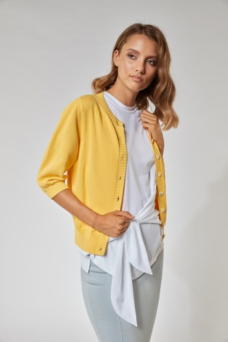 pure cotton cardigan from the Spring - Summer 2021 Collection, in the intense Pantone shade of Illuminating Yellow on a model