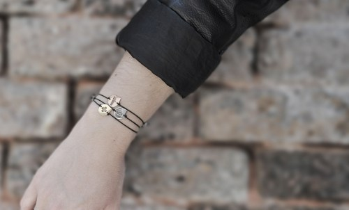 The three josa bracelet on the arm of a model showing the three colors and the three designs