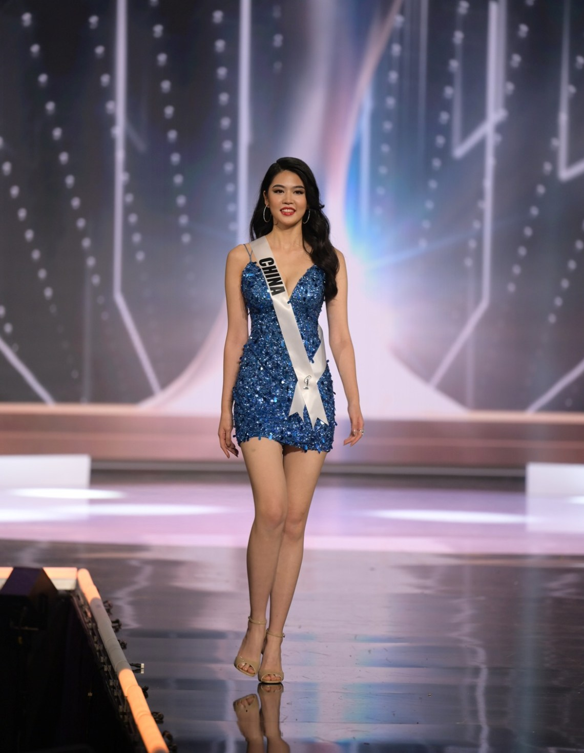 Jiaxin Sun, Miss Universe China 2020 on stage in fashion by Sherri Hill during the opening of the MISS UNIVERSE® Preliminary Competition at the Seminole Hard Rock Hotel & Casino in Hollywood, Florida on May 14, 2021. Tune in to the live telecast on FYI and Telemundo on Sunday, May 16 at 8:00 PM ET to see who will become the next Miss Universe.