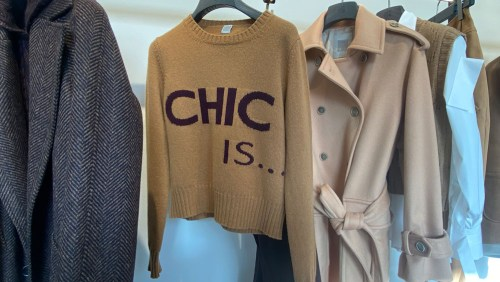 """Sweater hanging with text """"chic is..."""""""