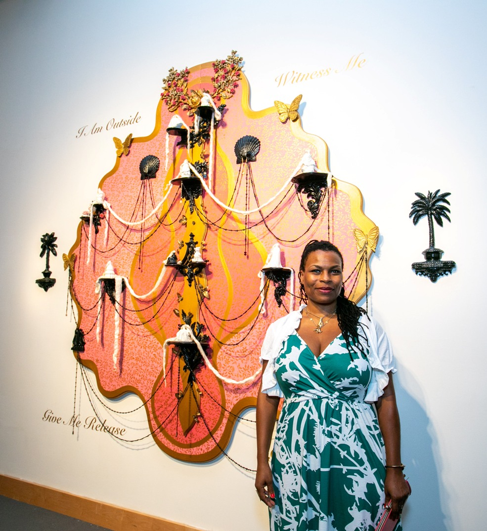The artist Vickie Pierre with one of her artworks, at the opening reception of her new exhibition on view now through September 5 at the Boca Raton Museum of Art.