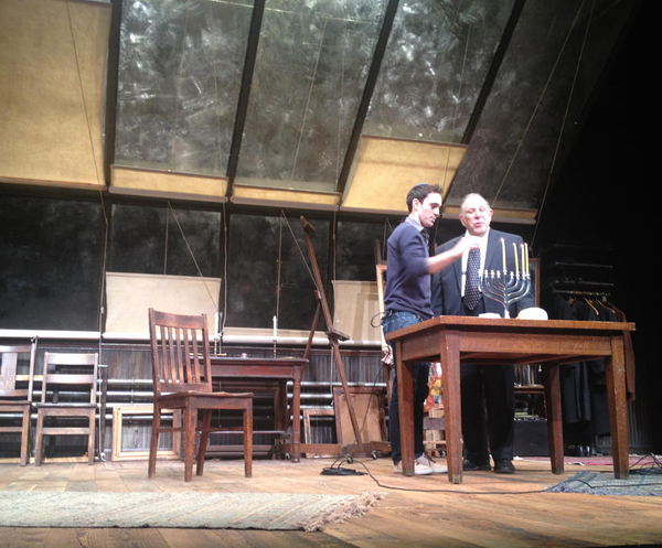 """Ari Brand, the star of """"My Name is Asher Lev,"""" lights Hanukah candles on the stage (not part of the show.)"""