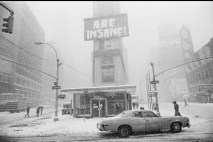 "Broadway during the blizzard of 1978. It was definitely insane out there, but that sign is from the advertising slogan from an electronics retail chain called Crazy Eddie: ""Our prices are insane."""