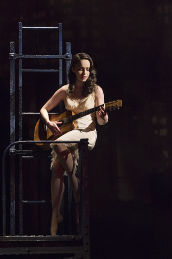 "Emilia Clarke as Holly Golightly in sultry slip and guitar singing in ""Breakfast at Tiffany's"" on Broadway"