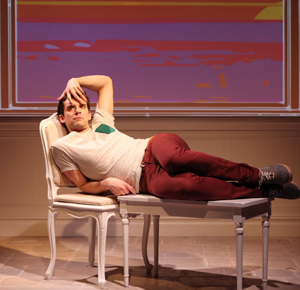 "Michael Urie as Barbra Streisand's employee Alex (and Streisand's hand running through Alex's hair) in ""Buyer and Cellar"""