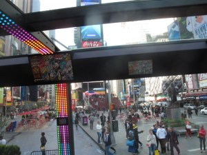 The Ride passes by Father Duffy Square