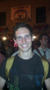 """Cory Michael Smith, rising young star known to theatergoers for his roles in """"Breakfast At Tiffany's,"""" """"Cock"""" and """"The Whale,"""" stands in front of the Stonewall Inn celebrating the rulings by the Supreme Court on gay marriage."""
