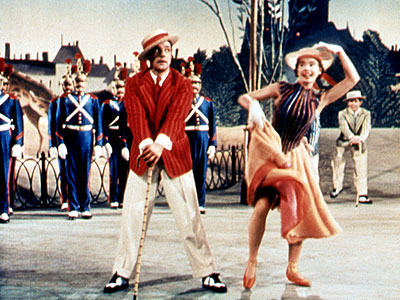 scene from the 1951  film An American in Paris with Gene Kelly and Leslie Caron.