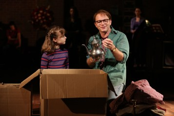 """Fun Home: When the adult Alison (Beth Malone) rummages through a box full of an antique teapot and other belongings of her long-dead father – and her father (Michael Cerveris) is looking through an identical box with the identical items with """"Small Alison"""" – another actress (Sydney Lucas) playing Alison as a child. A neighbor threw out these items thinking they were junk, but Alison's father realizes they are treasures – that old piece of cloth is gorgeous Irish linen; that tarnished teapot is silver:"""