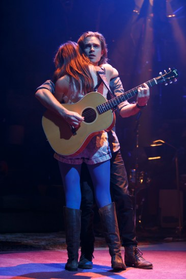 What's It All About: Kyle Riabko sandwiches Laura Dreyfuss between his body and his guitar, so that they are embracing, dancing and singing a song, all at the same time.