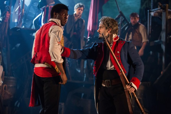 Kyle Scatliffe as Enjolras and Ramin Karimloo as Valjean
