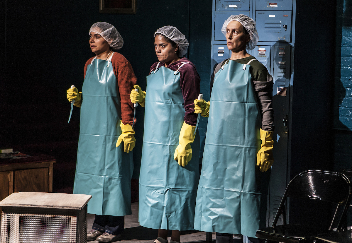 Liza Fernandez, Annie Henk and Lisa Ramirez working in the poultry plant