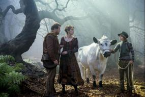 The Baker (James Corden), his wife (Emily Blunt) Milky-White the cow (Tug) and Jack of Jack and the Beanstalk (Daniel Huttlestone)