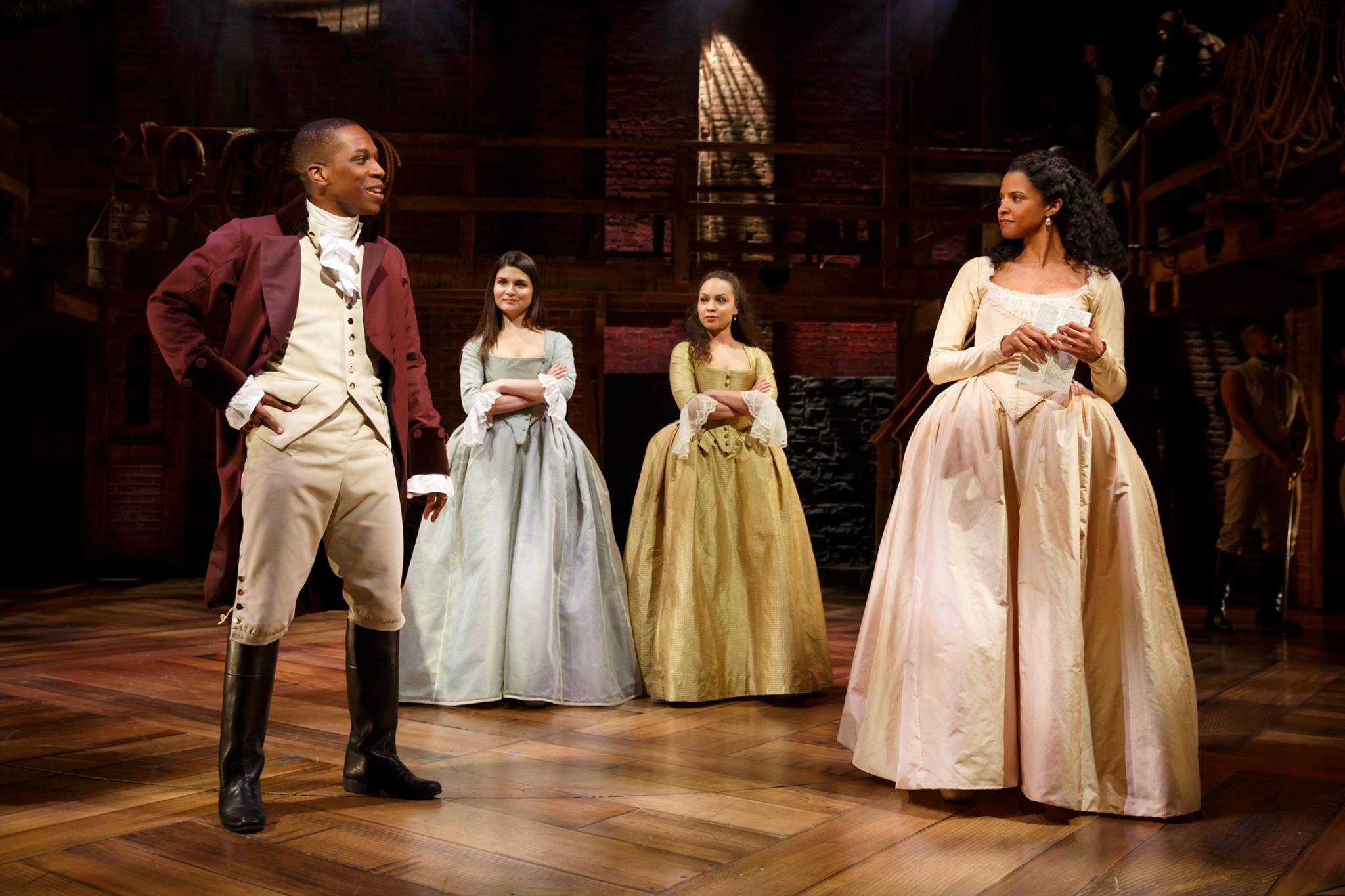 Leslie Odom Jr., as Aaron Burr, Phillipa Soo as Eliza Hamilton, Jasmine Cephas Jones, and Renée Elise Goldsberry as members of the Schuyler family.