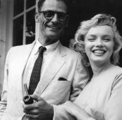 American film star Marilyn Monroe (1926 - 1962) outside her home iwith her third husband American playwright Arthur Miller.