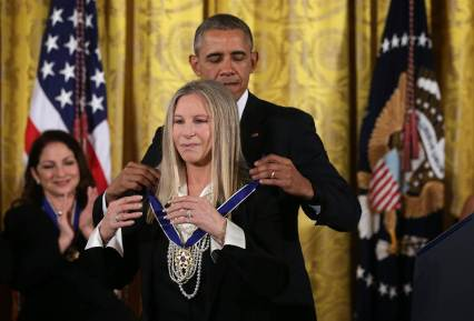 Barbra Streisand getting the Presidential Medal of Freedom from President Obama.