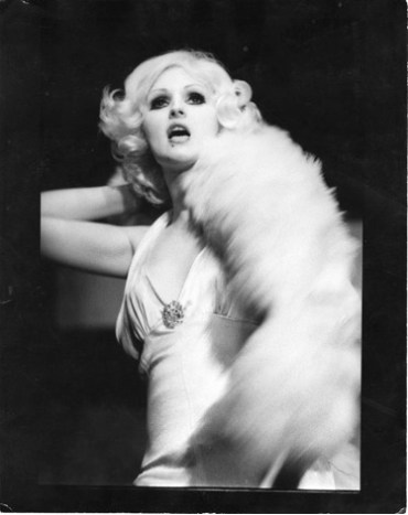 """Candy Darling performing the role of the White Whore in Tom Eyen's """"The White Whore and the Bit Player"""" (La MaMa, 1973)."""
