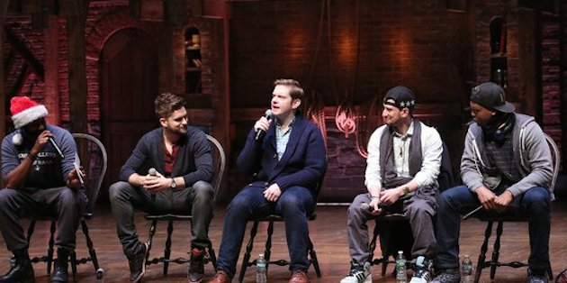 """Hamilton cast members (left to right) Nik Walker, Neil Haskell, Rory O'Malley, Roddy Kennedy, Quinton Johnson speak to 1,300 New York City public high school students before a matinee performance of """"Hamilton"""""""