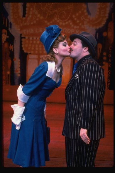 """Nathan Lane and Faith Prince kissing in a scene from the 1992 Broadway revival of the musical """"Guys And Dolls""""."""