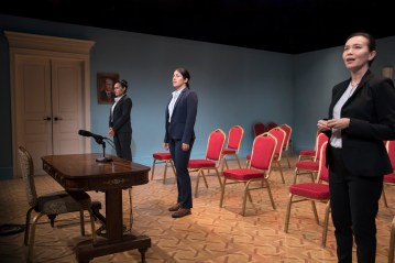 """The set of """"Intractable Woman"""" is a re-creation of a Russian press room, complete with a picture of Russian President Vladimir Putin on the wall."""