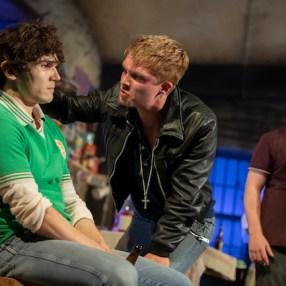Tom Glynn-Carney as Shane Corcoran, center, The Ferryman (in-between Fra Fee as Michael Carney, and Conor MacNeill as Diarmaid Corcoran)