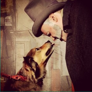 Scrooge and Bravo the dog in A Christmas Carol the musical at the Players Theater