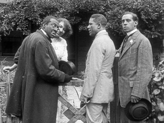 """Black actor Bert Williams (far left) performs in blackface in the """"Bert Williams Lime Kiln Field Day Project"""" (1913), believed to be the oldest surviving film footage featuring black actors, recently discovered and restored by the Museum of Modern Art Film Archive."""