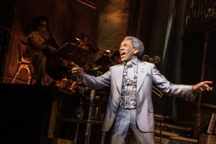"Andre De Shields commands the stage in Hadestown from the get-go. The show begins in complete silence as the rest of the cast watches Hermes, in his elegant, grey silk suit, slide across the stage, pause, and open a button to show a loud and splendid vest, before trombone player Briane Drye lets out a blast from jazz heaven and De Shields launches into the get-down ""Road to Hell."" It's the quietest, and most mesmerizing, opening of any show on Broadway."
