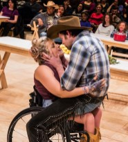 "Ali Stroker as the fun-loving, oversexed Ado Annie in ""Oklahoma!"", teases and kisses, flirts with and sings to the dim Will Parker (James Davis), -- and most memorably swings with him gleefully on her wheelchair."