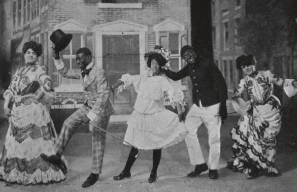 Hattie McIntosh, George Walker, Ada Overton Walker, Bert Williams, and Lottie Williams performing cakewalk in the Broadway production of In Dahomey, ca. 1903–1904.