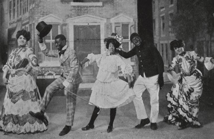 Hattie McIntosh, George Walker, Ada Overton Walker, Bert Williams, and Lottie Williams performing cakewalk in the Broadway production of In Dahomey, ca. 1903–1904.
