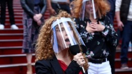 """Bernadette Peters singing """"Sunday"""" from Sondheim's """"Sunday in the Park with George"""" on the red steps of Broadway with many other (socially distanced) theater artists in October."""