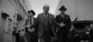 MANK (2020) Gary Oldman as Herman Mankiewicz, Arliss Howard as Louis B. Mayer and Tom Pelphrey as Joe Mankiewicz. NETFLIX