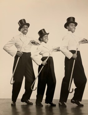 "Ananias ""Nyas"" Berry (1913-1951) and his brother James (1915-1969) were born in New Orleans, and, after a few early stints performing in Denver and Hollywood, made their New York debut in 1927 at ages 13 and 11. The Nicholas Brothers, regular Club headliners, found their flashy, signature leaps and jumps outdone by the Berrys' astounding finale: a synchronized flying and tumbling split-legged catapult over the heads of the band."