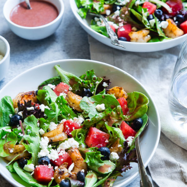 A fresh salad of greens, red pepper, blueberries grilled shrimp and goat cheese with a raspberry vinaigrette.